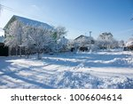 winter street in the snow  a... | Shutterstock . vector #1006604614