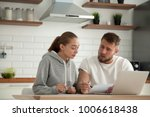 focused young couple checking... | Shutterstock . vector #1006618438
