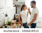 young smiling couple preparing... | Shutterstock . vector #1006618513
