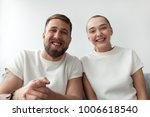 smiling young couple with happy ... | Shutterstock . vector #1006618540