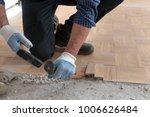 worker removes old parquet.... | Shutterstock . vector #1006626484