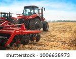 red tractor working in a field... | Shutterstock . vector #1006638973