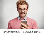 angry irritated male reads text ... | Shutterstock . vector #1006651048