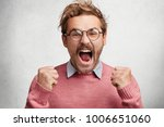 furious crazy handsome young... | Shutterstock . vector #1006651060
