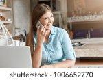 indoor shot of inspired female... | Shutterstock . vector #1006652770