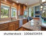 gourmet kitchen boasts a bar... | Shutterstock . vector #1006653454