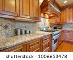 gourmet kitchen boasts a curved ... | Shutterstock . vector #1006653478