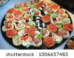 brochettes and small sandwiches | Shutterstock . vector #1006657483