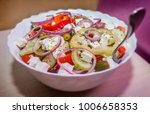 fresh greek salad  | Shutterstock . vector #1006658353
