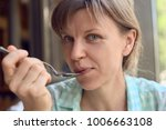 young woman eating | Shutterstock . vector #1006663108