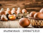 brown eggs in wooden basket.... | Shutterstock . vector #1006671313