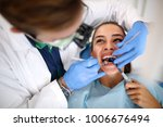 young female patient on dental... | Shutterstock . vector #1006676494