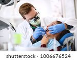 dentist make checkup of female  ... | Shutterstock . vector #1006676524