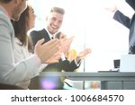 Small photo of Photo of partners clapping hands after business seminar. Professional education, work meeting, presentation or coaching concept.Horizontal,blurred background