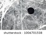 hockey puck on a frozen pond | Shutterstock . vector #1006701538