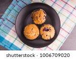 Fresh Muffins On A Dark Plate...