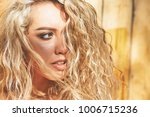 beautiful curly blonde portrait | Shutterstock . vector #1006715236