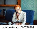 redhead businesswoman working... | Shutterstock . vector #1006728109