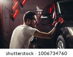 car detailing   the man holds... | Shutterstock . vector #1006734760