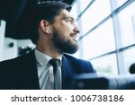 man with wireless earpiece | Shutterstock . vector #1006738186