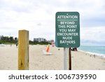 Small photo of Sign in the beach with attention about clothing