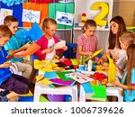 children and colored paper.... | Shutterstock . vector #1006739626