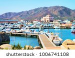port with ships and yachts ... | Shutterstock . vector #1006741108