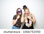 Stock photo two young girls pose photo booth props happy funny white background smile models 1006752550