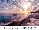 silhouettes at sunset near... | Shutterstock . vector #1006755289