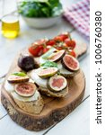 fresh ripe sliced fig on toast... | Shutterstock . vector #1006760380