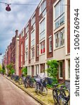 amsterdam street with bicycles... | Shutterstock . vector #1006760944