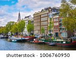 lots of boats on the bank of... | Shutterstock . vector #1006760950