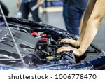 hand of auto mechanic with a... | Shutterstock . vector #1006778470