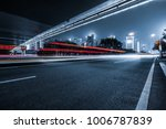 the light trails on the modern... | Shutterstock . vector #1006787839
