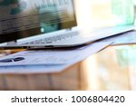 working place with laptop ... | Shutterstock . vector #1006804420