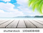 empty wooden table and palm...   Shutterstock . vector #1006808488