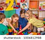 children building blocks in... | Shutterstock . vector #1006812988