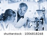 health care researchers working ... | Shutterstock . vector #1006818268