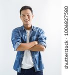 attractive smiling young asian... | Shutterstock . vector #1006827580
