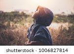 baby boy in a blue jacket... | Shutterstock . vector #1006827814