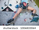 teen girl climbing a rock wall... | Shutterstock . vector #1006833064