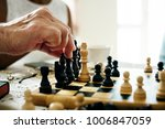 senior friends playing chess... | Shutterstock . vector #1006847059