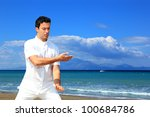 guy meditating by the sea | Shutterstock . vector #100684786