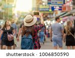 back side of young asian... | Shutterstock . vector #1006850590