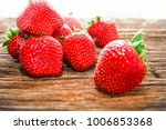 sweet red strawberry on wood... | Shutterstock . vector #1006853368