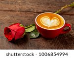 fresh cappuccino with red rose... | Shutterstock . vector #1006854994