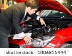 man writing note on engine...   Shutterstock . vector #1006855444