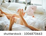 loving married couple on the bed | Shutterstock . vector #1006870663