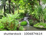 waterfall in decorative... | Shutterstock . vector #1006874614
