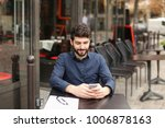 gladden male person sitting at... | Shutterstock . vector #1006878163